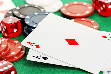 closeup of two aces with chips and dice, gambling concept Stock Photo