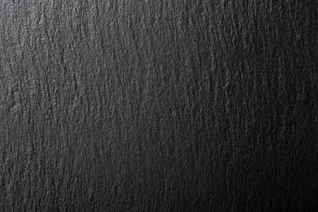 黒いスレート テクスチャ背景の不均一な光
