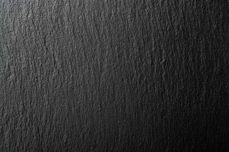 black slate texture with uneven light for backgrounds
