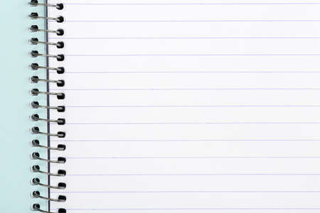 notebook page: blank page of spiral notebook, closeup for messages