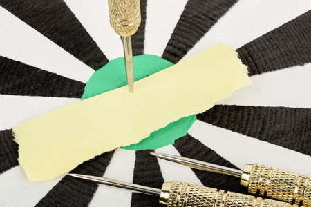 message board: blank paper on dart board for your message Stock Photo
