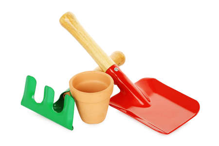 rake, shovel and flower pot isolated on white, gardening concept Stock Photo