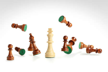 white chess king among scattered pawns on white