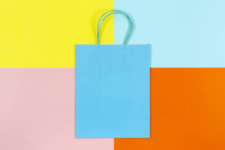 blank shopping bag on colorful paper, shopping concept or background Stock Photo