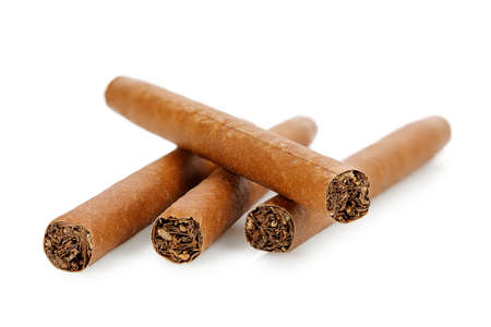 closeup of four cigars isolated on white