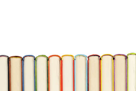top view of a row of colorful books with copy space