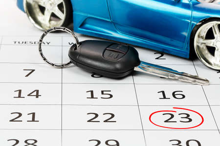 car key on calendar and circled date, concept for new car
