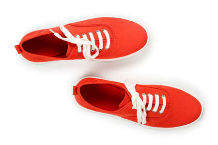 pair of red suede shoes on white, top view
