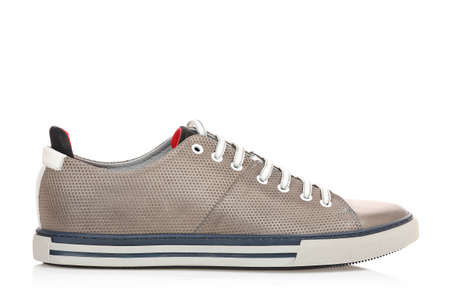 single grey leather sneaker isolated on white, side view Stock Photo