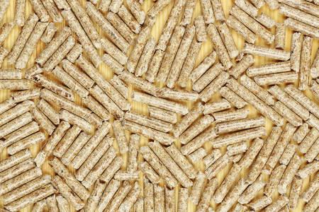 wood pellets on wooden surface, alternative heating Stockfoto