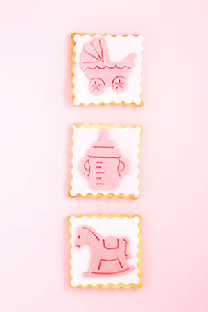 pastries with pink stroller, feeding bottle and horse, newborn girl concept 免版税图像