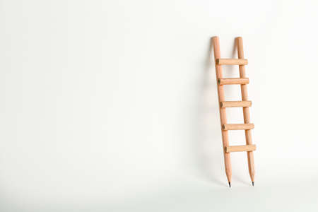 pencil ladder on white with copy space, education concept