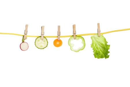 variety of vegetables on clothesline, healthy eating concept Standard-Bild - 117200379