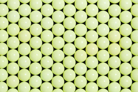 many yellow plastic balls closeup for backgrounds, abstract pattern