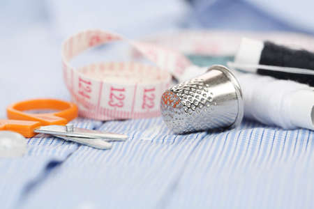 sewing equipment on blue shirt Imagens