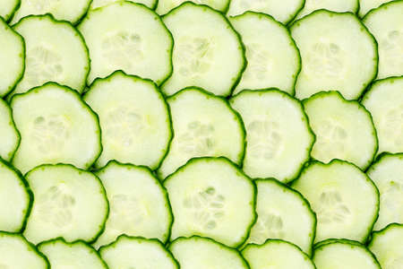 fresh cucumber slices closeup for backgrounds