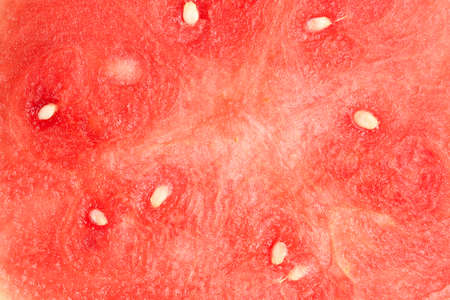 closeup of sliced watermelon with seeds and copy space