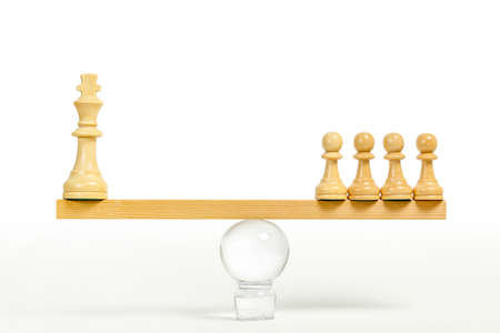 king chess piece weighing the same as chess pawns, equality concept