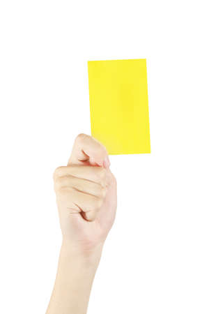 hand with yellow card isolated on white, yellow card is shown as a warning