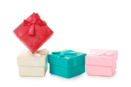 colorful gift boxes with ribbon isolated on white