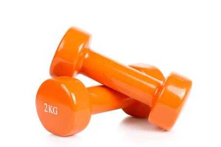 two orange dumbbells isolated on white