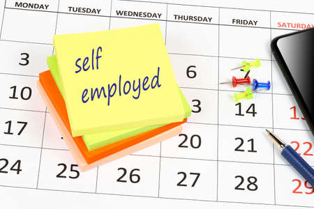 self employed written on sticky note, employment concept