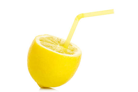 lemon with drinking straw isolated on white
