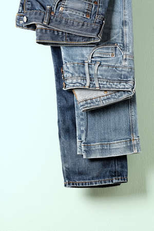 two pairs of blue jeans on hanger close up