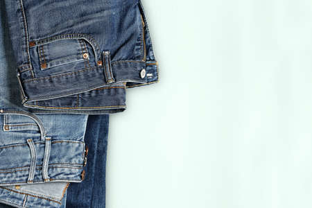 two pairs of blue jeans on hanger close up with copy space