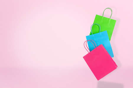 colorful shopping bags on pink with copy space, shopping concept Zdjęcie Seryjne