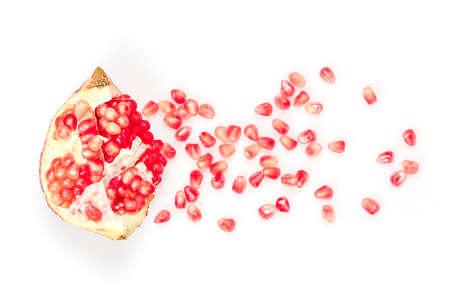 flat lay of pomegranate seeds on white surface Zdjęcie Seryjne