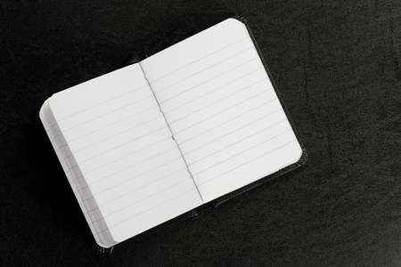 open and blank agenda book on black surface Zdjęcie Seryjne