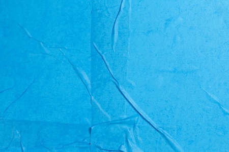 wet and wrinkled blue paper as background Zdjęcie Seryjne