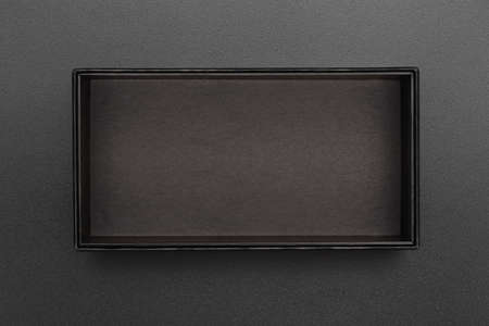 top view of empty black box on black surface
