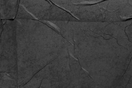 wet and wrinkled black paper as background