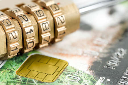 padlock with combination on credit card,  safety concept Zdjęcie Seryjne