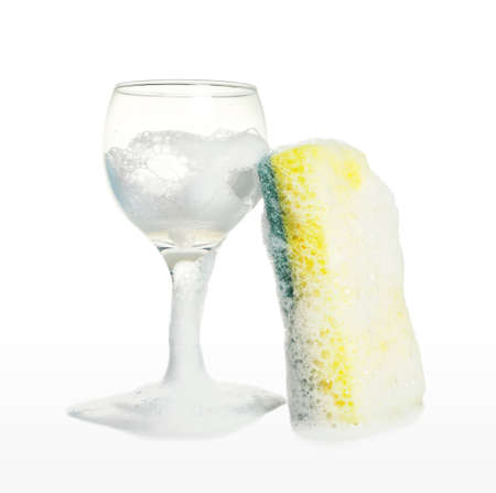 wine glass with kitchen sponge in foam isolated on white