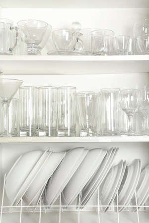 open cupboard with variety of glasses and dishes Zdjęcie Seryjne