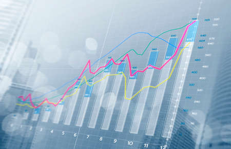 Business growth, progress or success concept. Financial bar chart and growing graphs with depth of field on bright tone background. Imagens