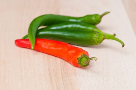 Green and red hot pepper photo