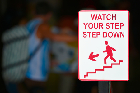 Watch your step sign - step down