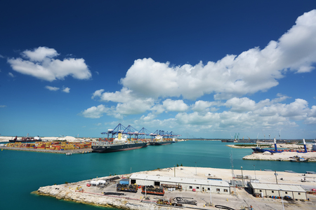 Beautiful view of the cranes and logistics at the harbour of FreePort with blue sky