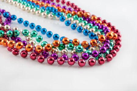 Mardi Gras necklaces on white Stock Photo - 24417480