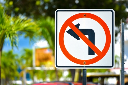 dissuade: No Left Turn Sign with natural background