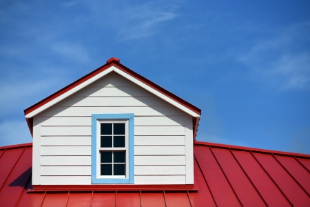 material: Close up a red roof detail house and a blue sky Stock Photo