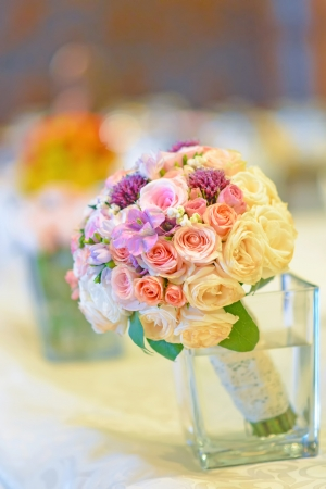 Bridal flowers on the table in the restaurant Stock Photo
