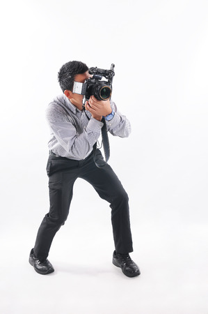 Professional male photographer taking picture   isolated on white background