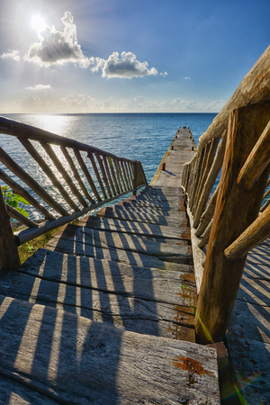 Wooden bridge on a beach in Cozumel, Mexico