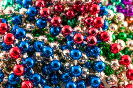 Mardi gras beads isolated on white  Stock Photo