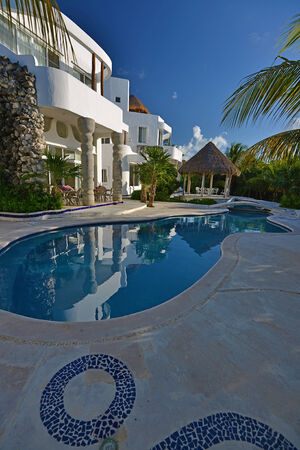 water feature: Luxury backyard view in sunset - Cozumel, Mexico  Editorial